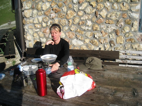 Me making breakfast outside Rifugio Puez