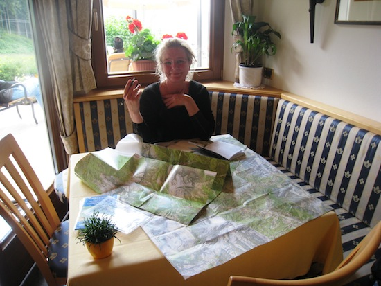 Heiða reading the maps at Garni Agheli